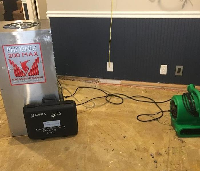 SERVPRO of LaPorte County-water damage. Flooring and trim have been removed. Air movers and dehumidifiers are set, to achieve and maintain an acceptable drying situation. Our crews will monitor the st
