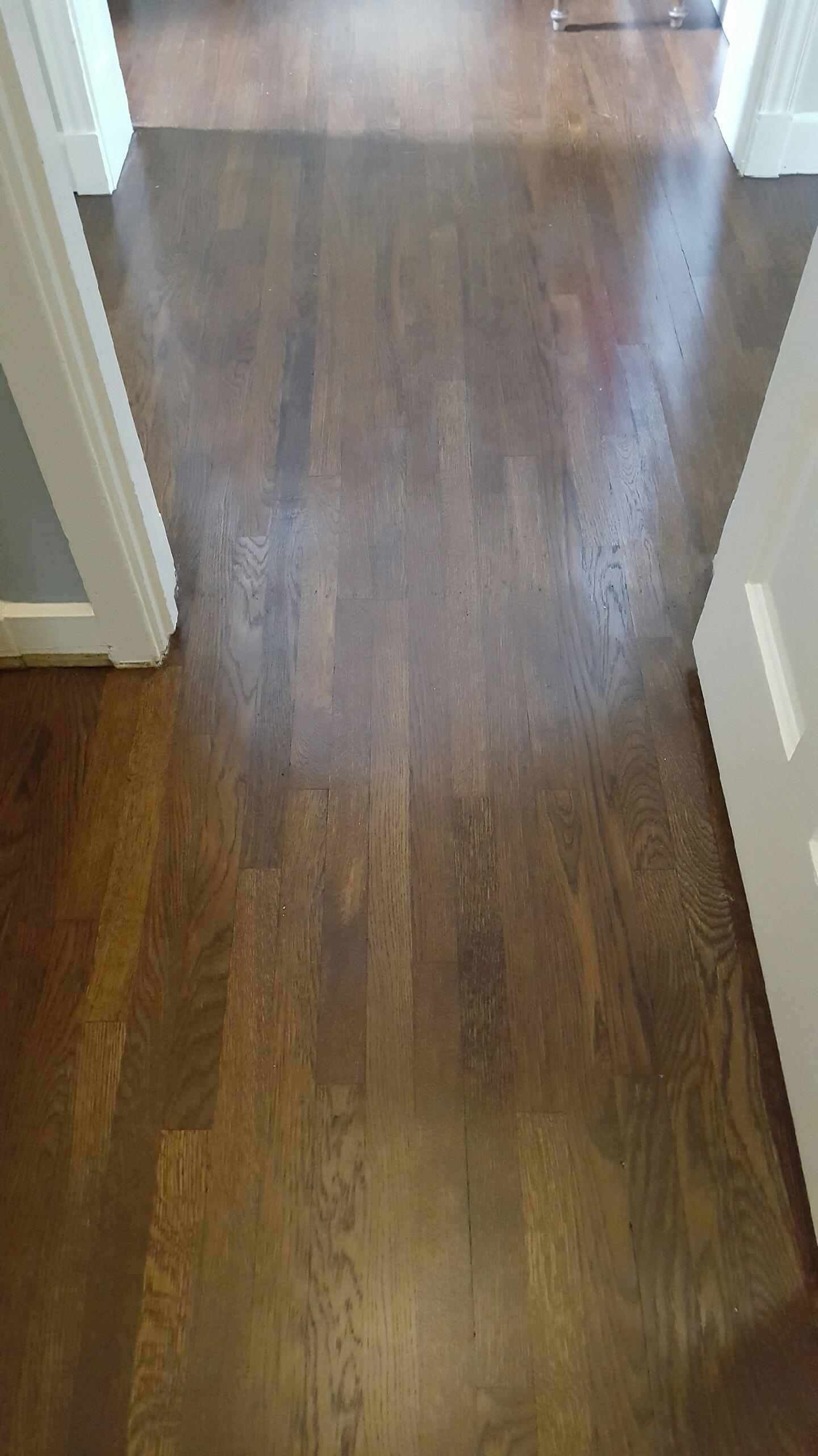 Floors now sanded and stained to match existing floors that were in the entry way.