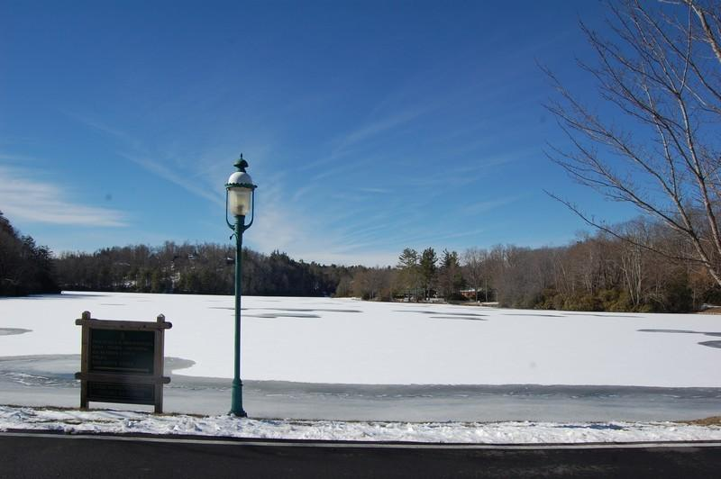 Linville Land Harbor's 45 acre trout stocked lake surrounded by green areas!