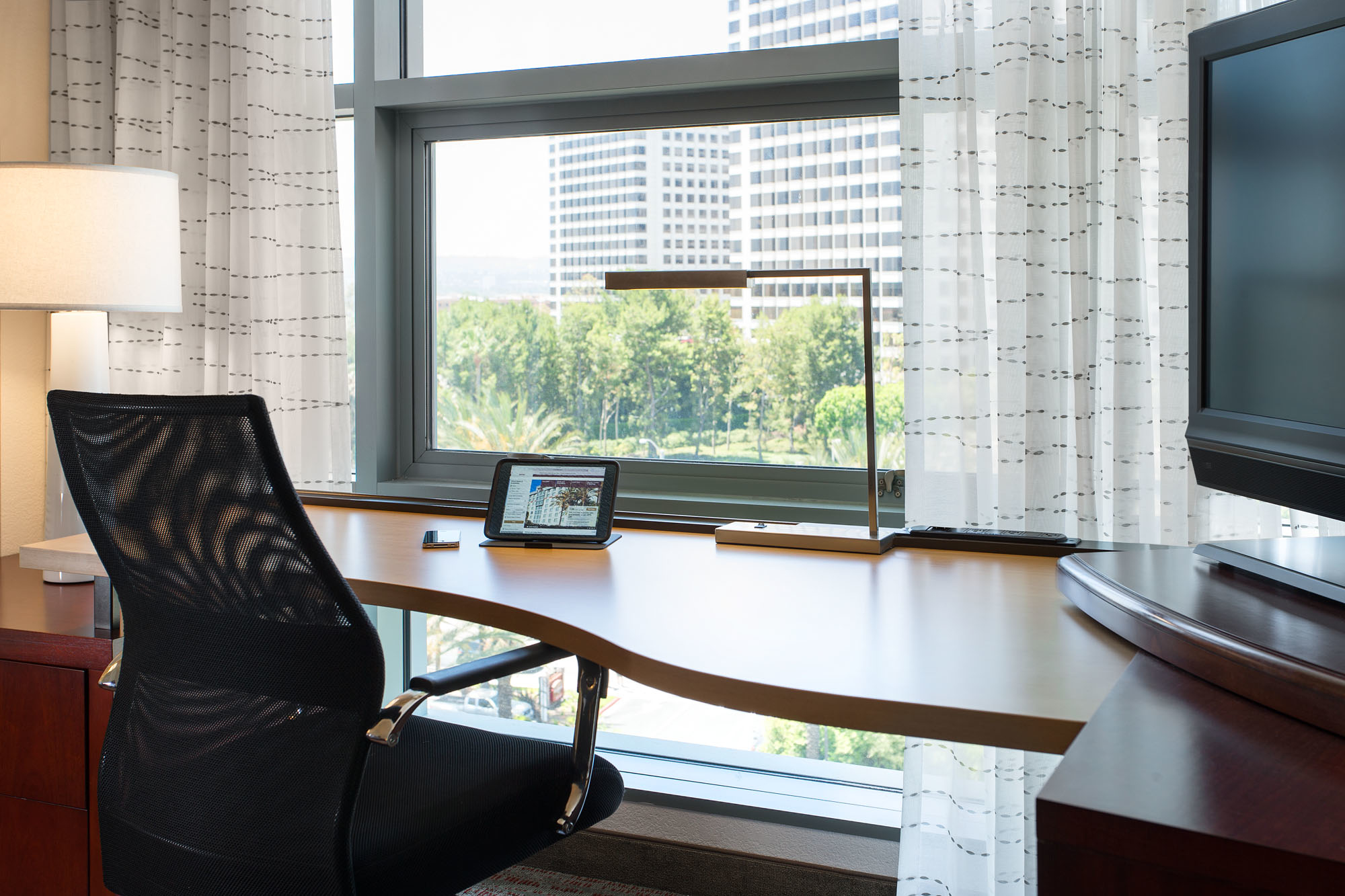 Suite Work Desk - Our spacious guest suites feature a well-lit work area. Stay productive with our large desks, ergonomic chairs and complimentary high-speed Internet.
