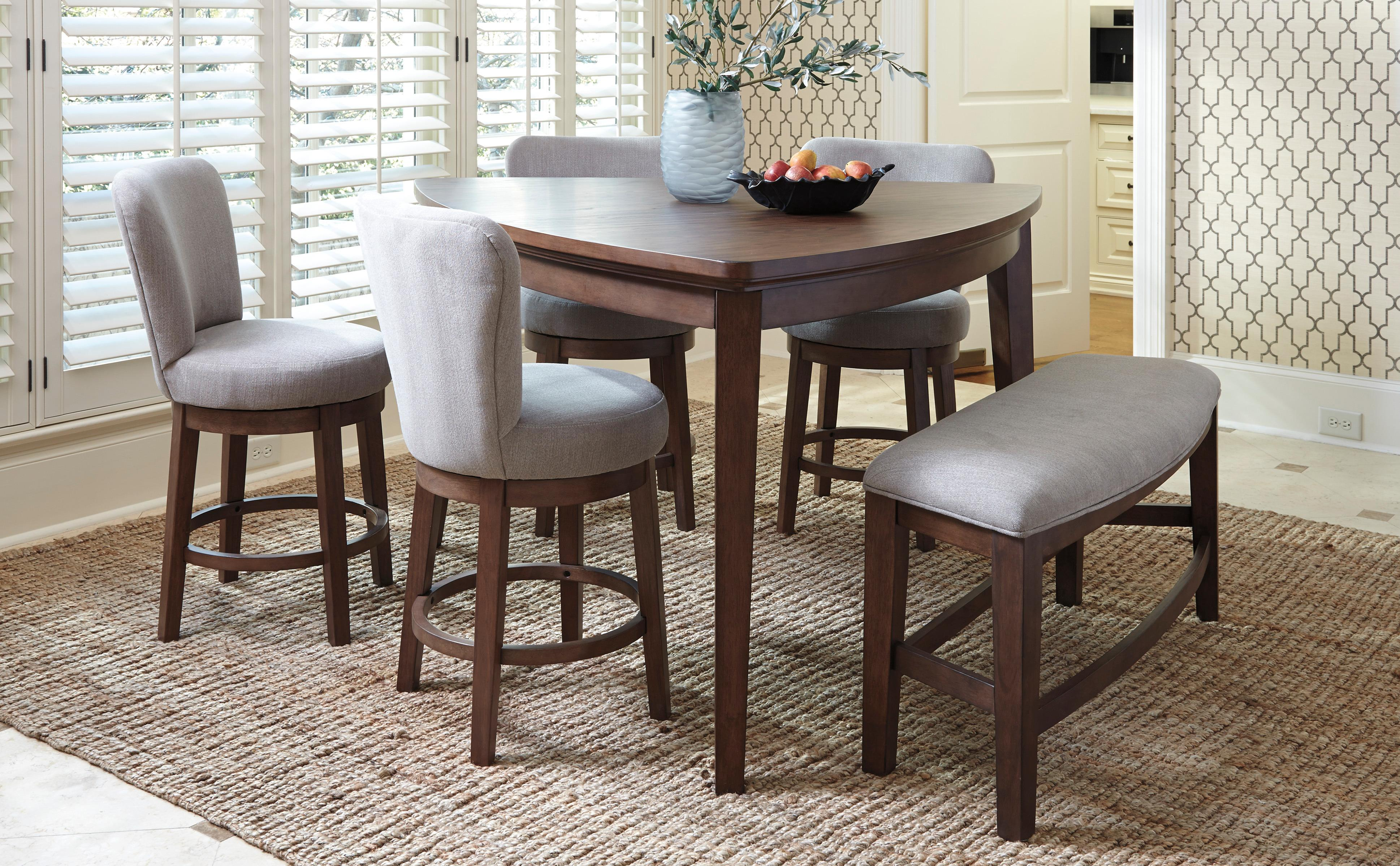 """March to the beat of your own drum with the Mardinny dining room counter height table. """"Guitar pick"""" shape strikes just the right note and wows from every angle. Counter height design makes eating in feel like dining out at your favorite pub. The cozy shape doubles as a card table and brings family game night back in style."""