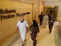 A patient and nurse at the Roberts Proton Therapy Center.