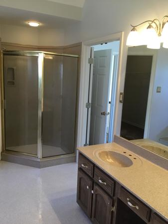As well as updating the look of the shower,  The Vanity & Jetted Bathtub & Surround was Dark Blue, Also the Tile Floor was refinished in a coordinating Natural Accent to give the whole Bathroom a Miracle!!