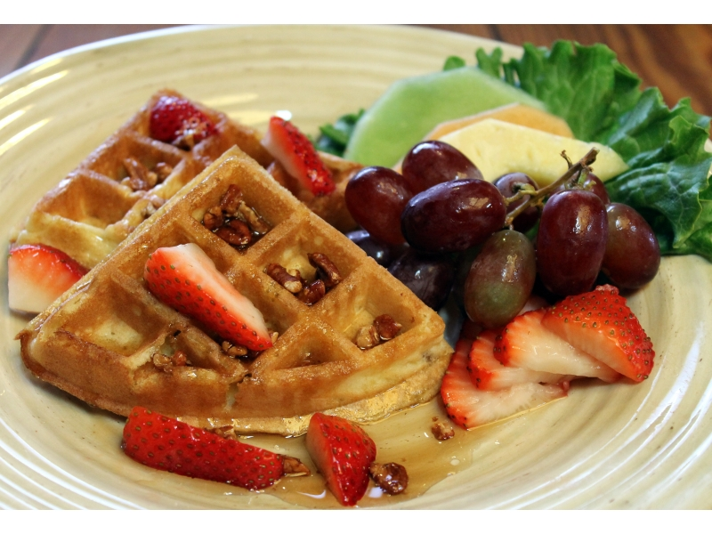 waffles, served with strawberries, toasted sweet pecans, maple syrup ...