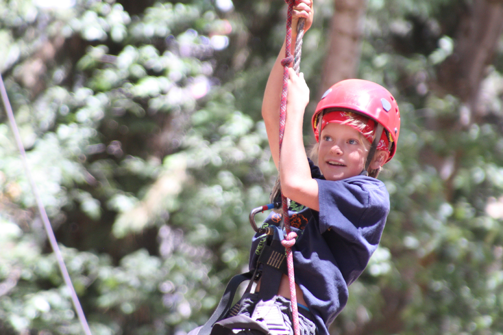 Camper on the ropes course at Pali Adventures Summer Camp