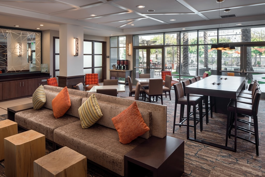 Breakfast Seating Area - Grab a table in our recently renovated dining area and fuel up for a day of adventure while savoring healthy and hearty options from our complimentary breakfast buffet.