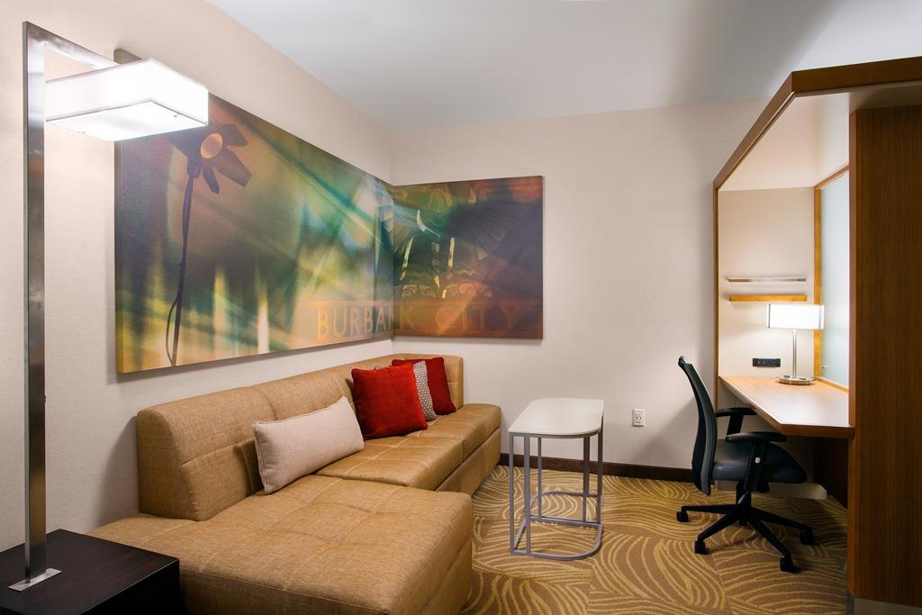 Suite Living Area - Following an adventure-filled day, kick back in our stylish living spaces while enjoying your Netflix, Hulu or Pandora accounts on LCD smart TVs, or catch up on business at the lar