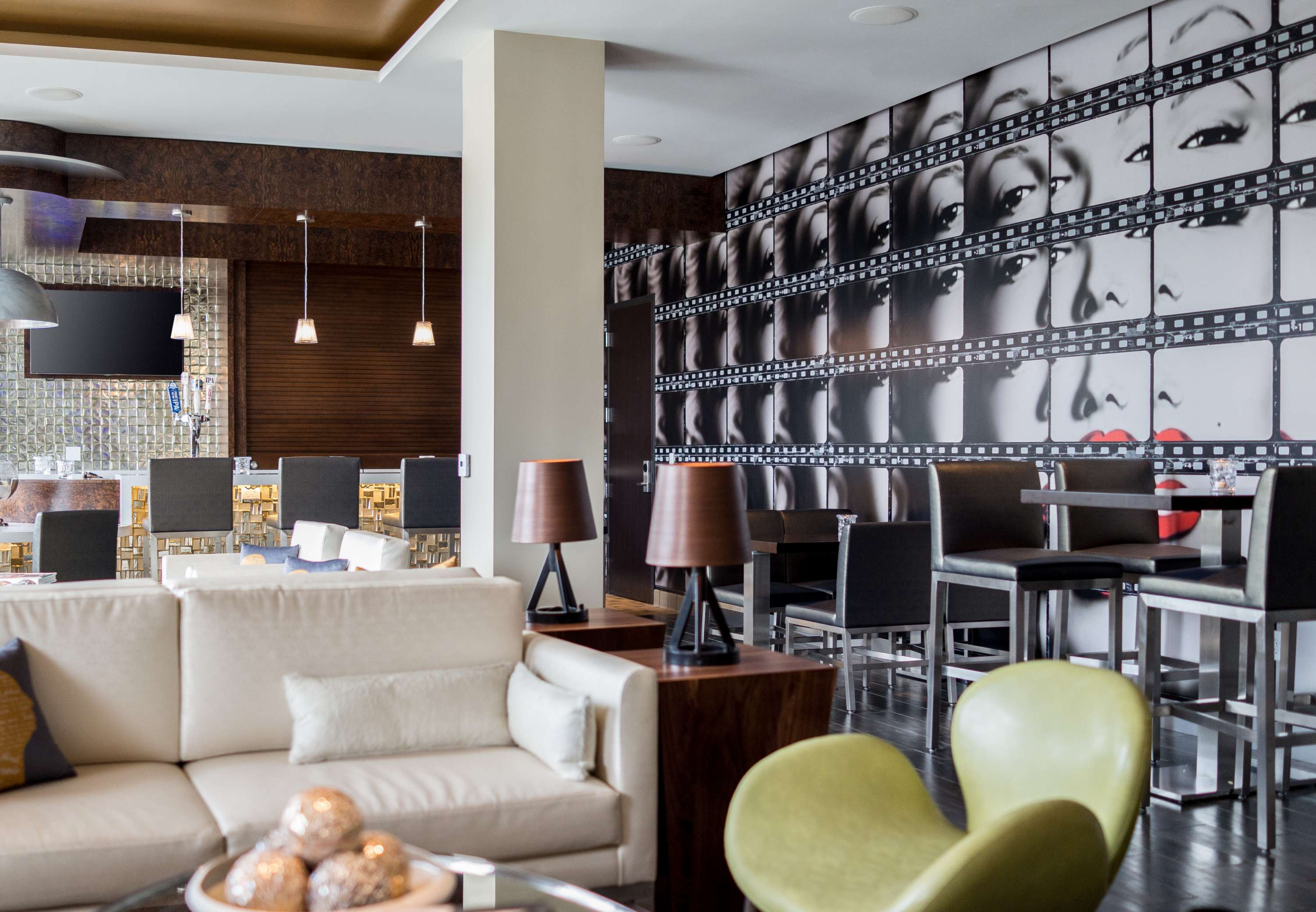Art Details Marilyn Monroe Art Wall - Inspired by the icon herself, our Marilyn Monroe art wall allows guests to revisit old Hollywood while enjoying drinks and socializing in a stylish lounge-like se