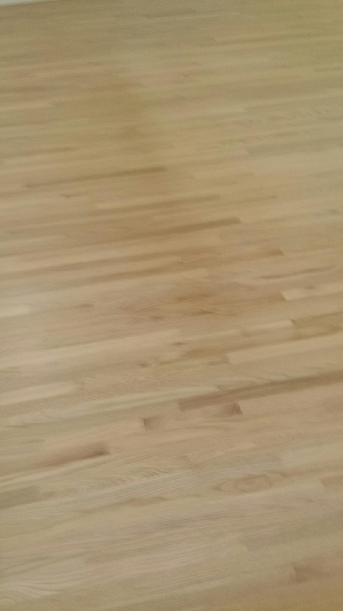 Sand oakwood floor, bleachwood, white color on top, finish white, 4 coats of non yellowing polyurethane.