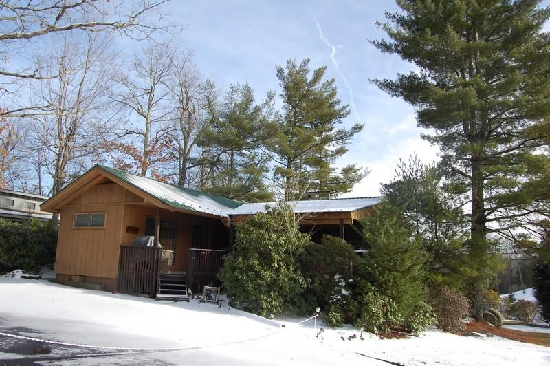 Charming 2 bedroom/2 bath on perimeter lot!  Beautiful stone fireplace, wrap around deck and hot tub!  Call us for details at 800-521-3712
