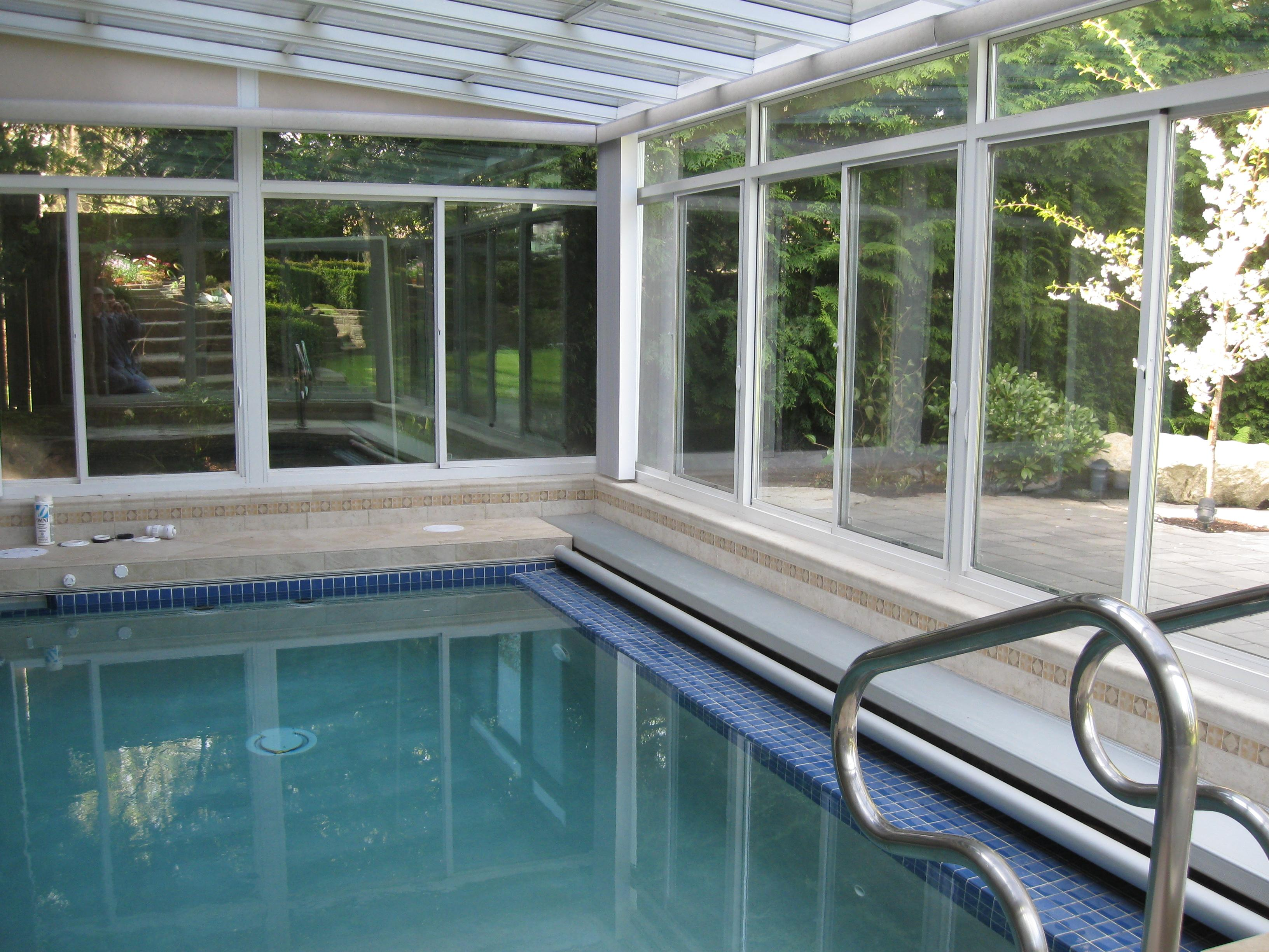 Four Seasons Sunrooms in Port Coquitlam: This customer had us build his first sunroom off his living room, one year later he wanted us to build a fitness room including this lap pool covered by a 2nd sunroom. We took care of all aspects of the project from permit to painting.