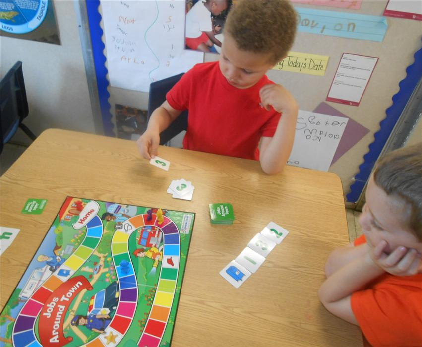 This is What Learning Looks Like: Building brain power in playing a math board game while learning to take turns, share and negotiate.