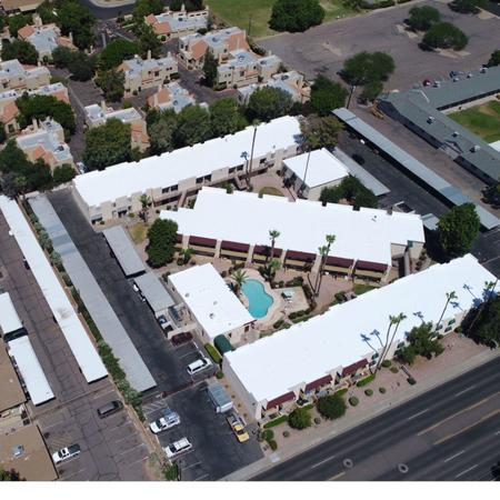 After of the apartment complex roofs we did a complete Repair and New white elastomeric top coat on the foam roofs.