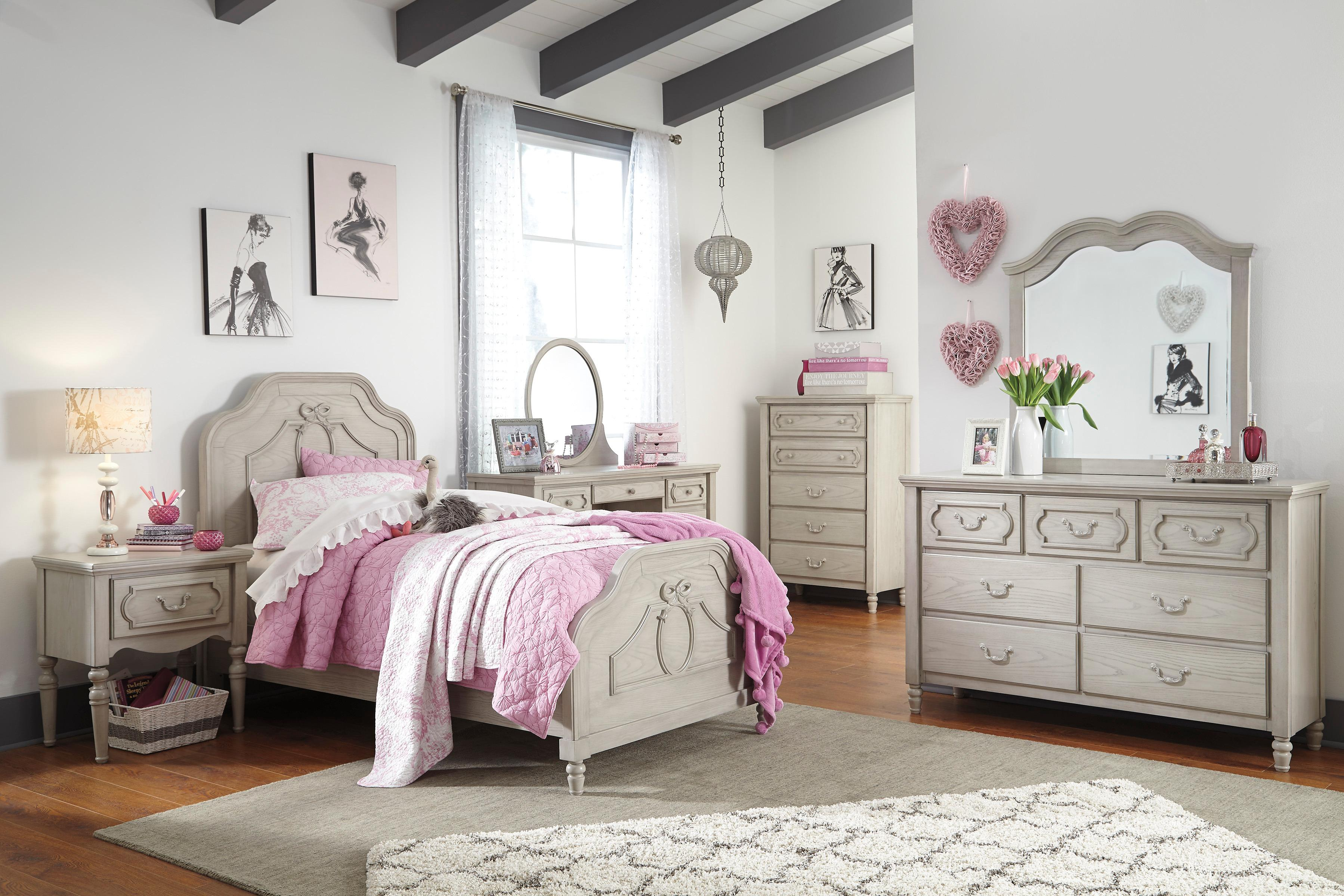 Abrielle twin panel bed's French country inspired design is a dream come true for your petite mademoiselle. Raised cameo details add a sweet, feminine touch. Ethereal finish complements any color scheme, from dusty rose to powder blue and every hue in between. Mattress available, sold separately.