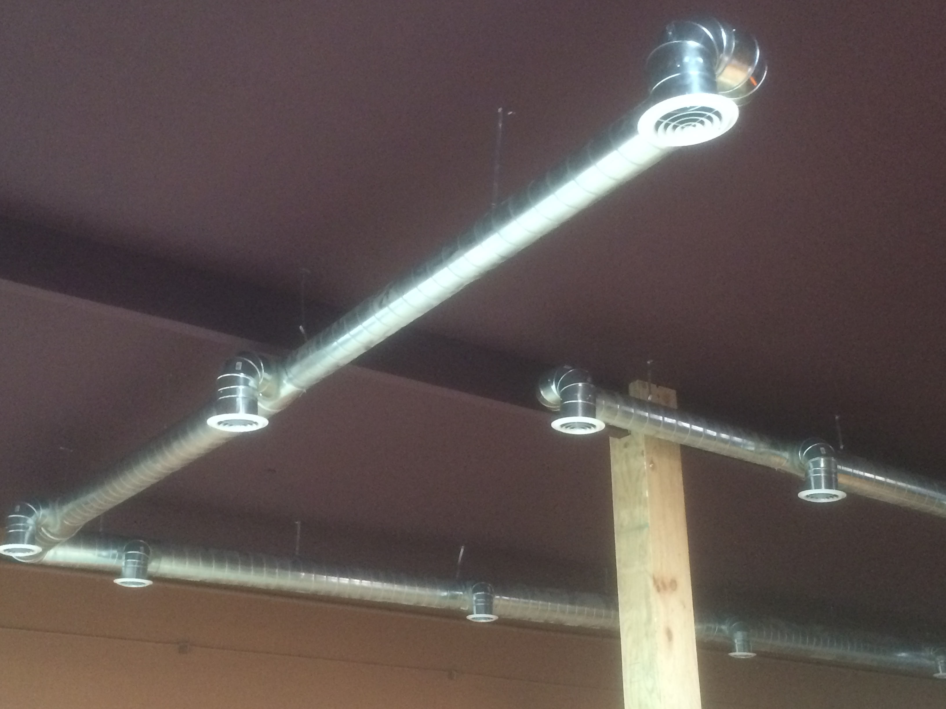 Exposed duct work in commercial building we installed