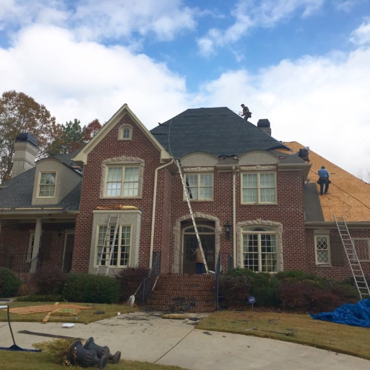 Capstone installing architectural shingles and copper roofing near Birmingham, Alabama.