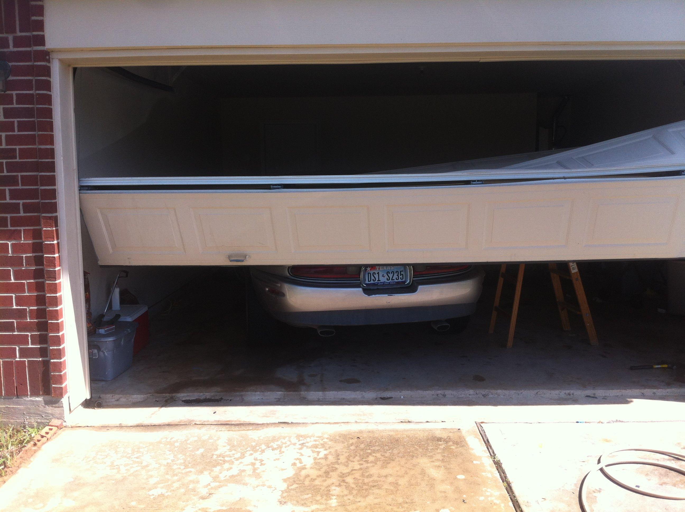 Grand garage door repair houston tx in houston tx 77081 for 24 7 garage door repair near me