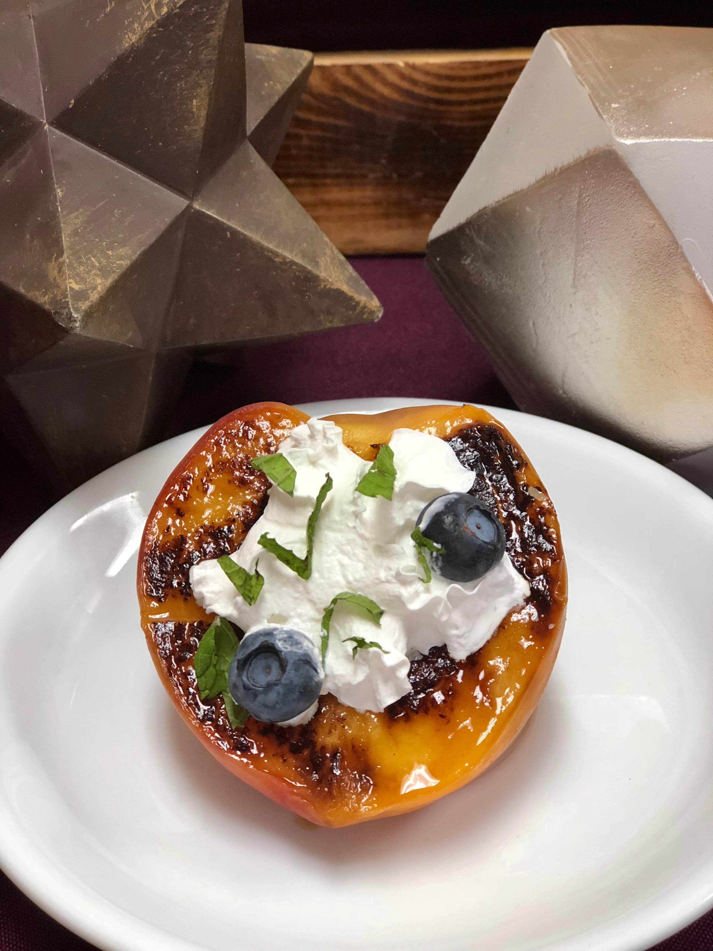 Grilled Peach with Whipped Cream, Blueberries, and Mint
