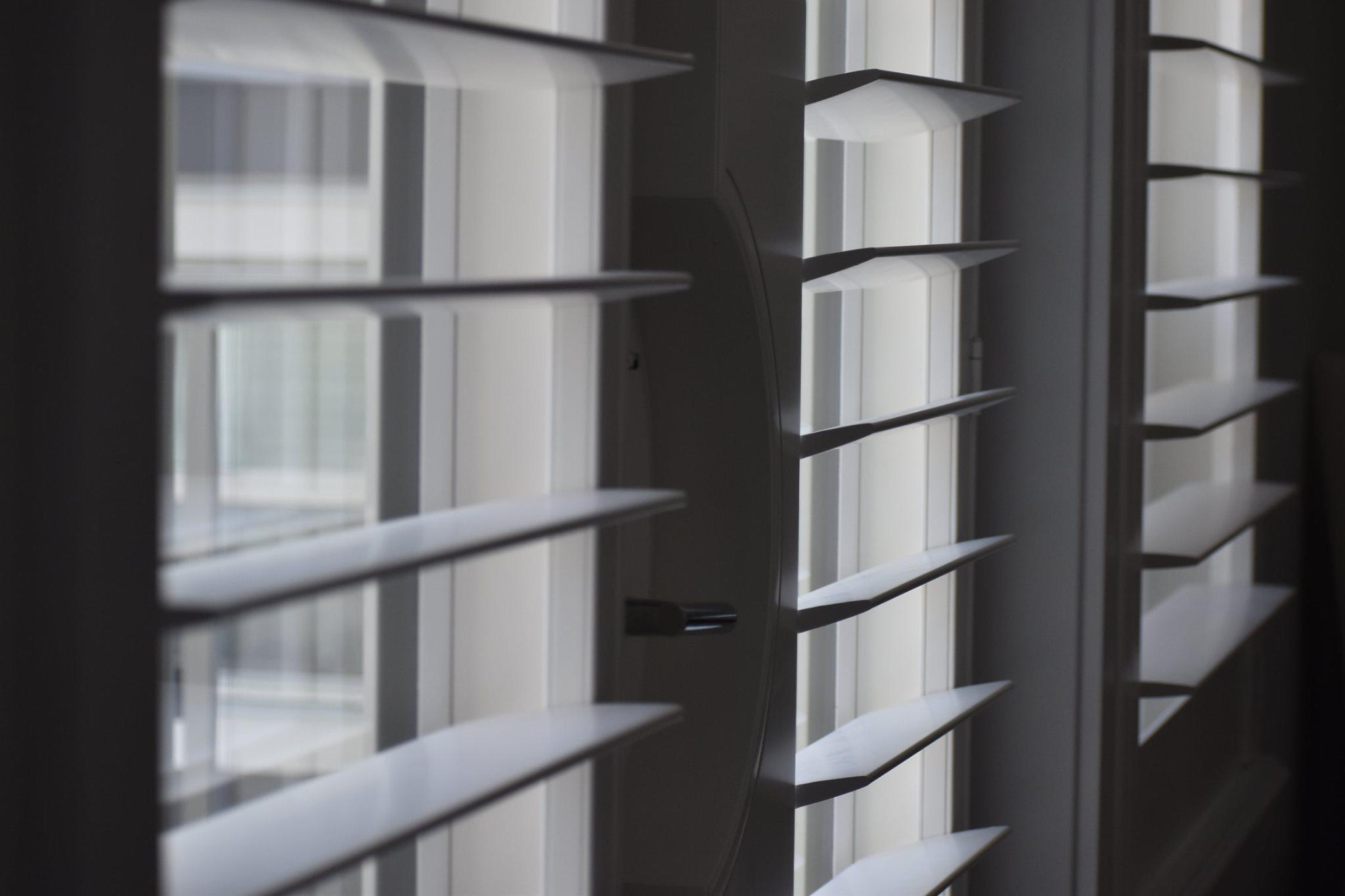 Budget Blinds of Delta, South Surrey and White Rock in Delta: Large Slat Shutters : These Norman large slat shutters created a dramatic look for our clients dining room, along with custom handle cut outs in a custom white to match their trim