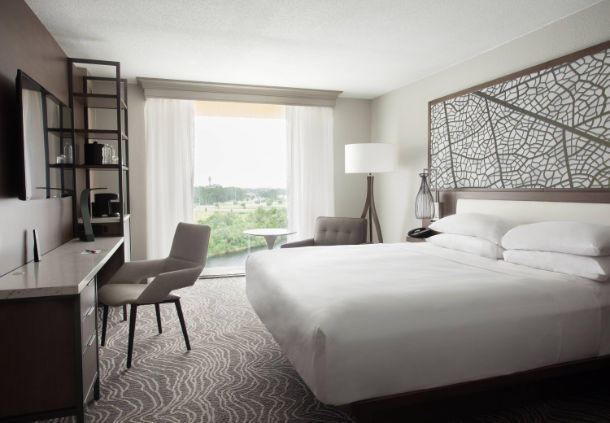 These stylishly appointed rooms offer a king bed, workspace and views of the lake.