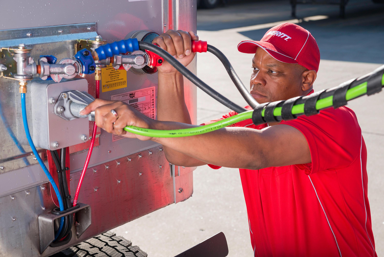 Averitt Express associate connects trailer to cab