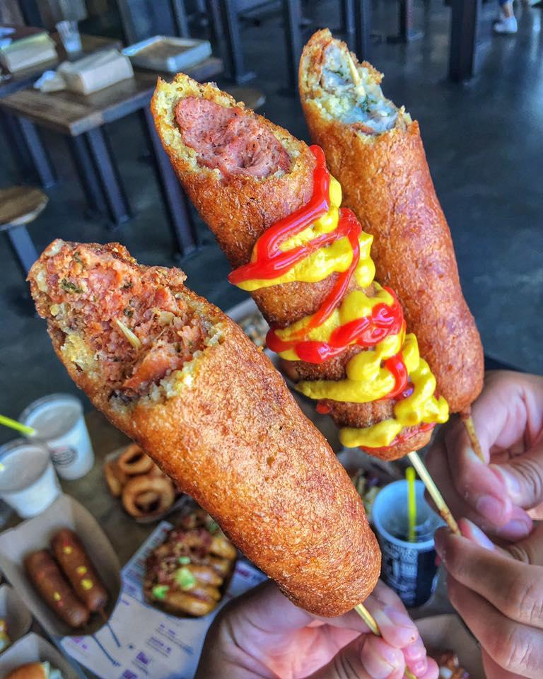 Dog Haus' Corn Dogs feature our very own root beer batter. Choose from a CLASSIC CORN DOG, or the WURST CORN DOG, which covers any of our gourmet sausages (made by Würstmacher Adam Gertler) with our signature batter.