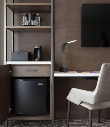 Reserve a Concierge level hotel room for enhanced amenities, including a mini-refrigerator.