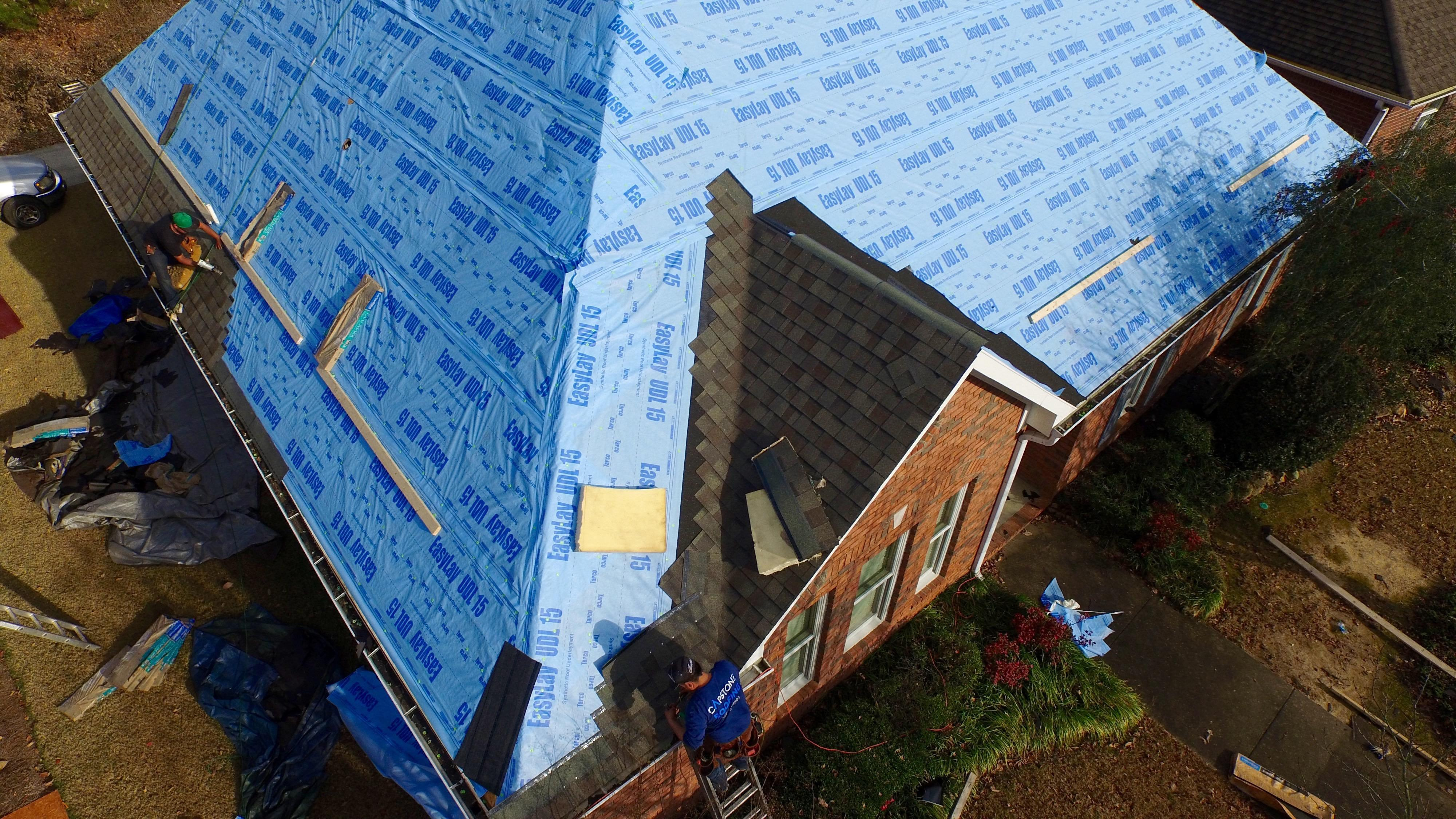 Capstone Roofing installing synthetic underlayment and architectural shingles shot with our Phantom 3 in Birmingham, Alabama.