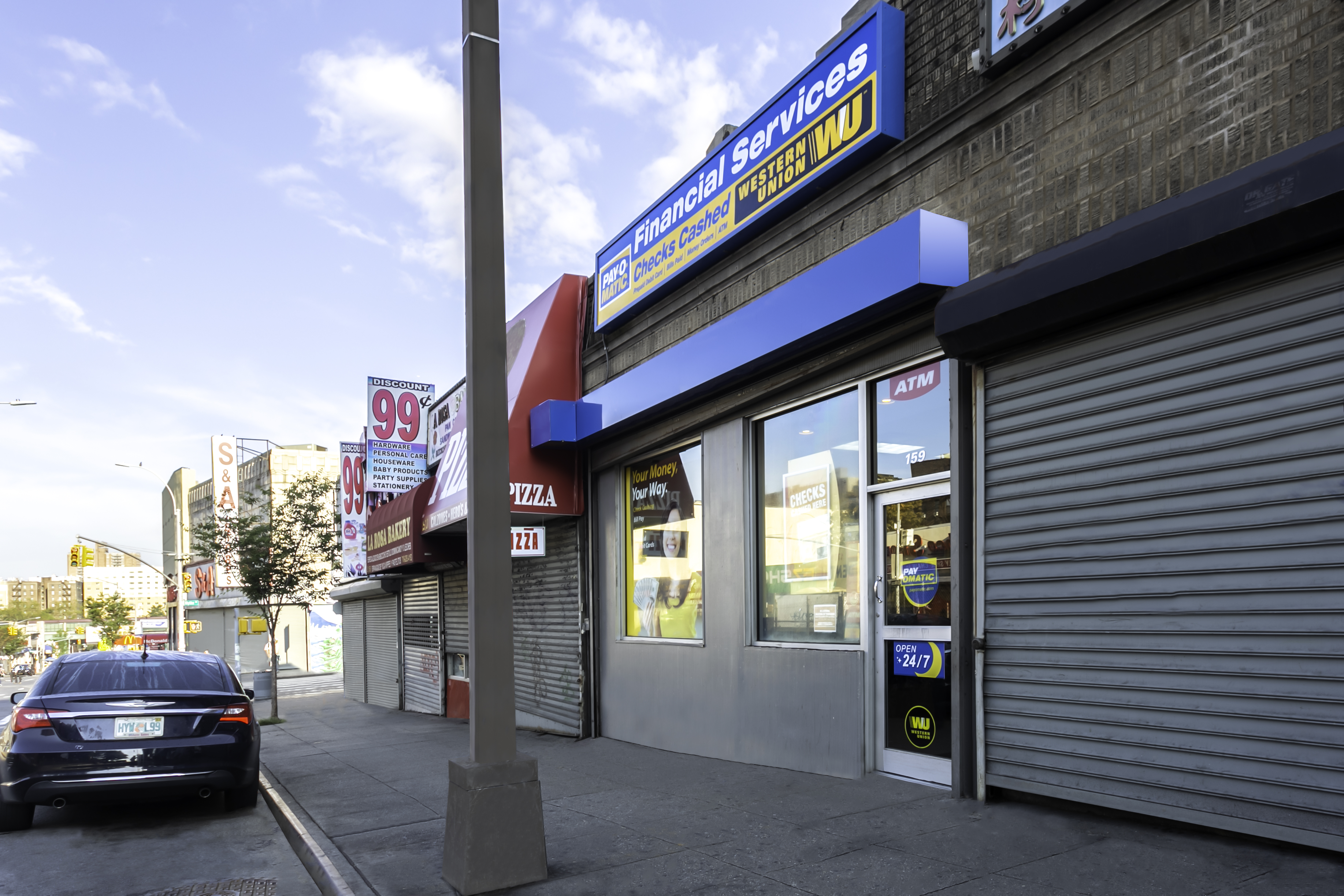 Exterior view from sidewalk of PAYOMATIC store located at 159 East 170th St Bronx, NY 10452