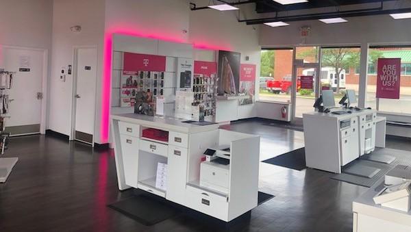 Interior photo of T-Mobile Store at W. Grand River Ave & Cross Street, Brighton, MI