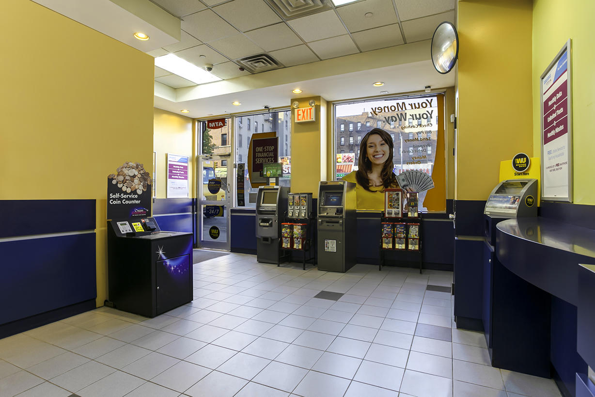 Customer waiting area and entrance inside PAYOMATIC store located at 159 East 170th St Bronx, NY 10452