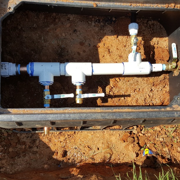 New multi valve water line. The valves on the bottom are for future options. the valve at the top is a yard hydrant. straight through for home.