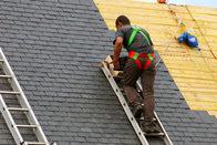 An asphalt shingle roofing expert in Wilmington, NC doing work