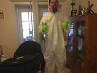 """SERVPRO of Charlottesville technician in full PPE, """"Here to Help"""" with your Biohazard, sewage back up, mold remediation, COVID-19 disinfecting, fire and water damage restoration."""