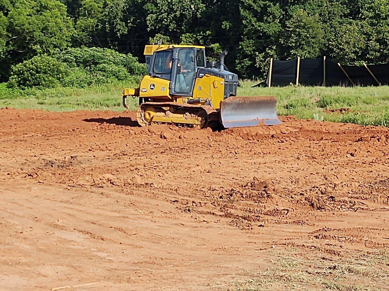 Swinging Ring Tractor Service and Construction