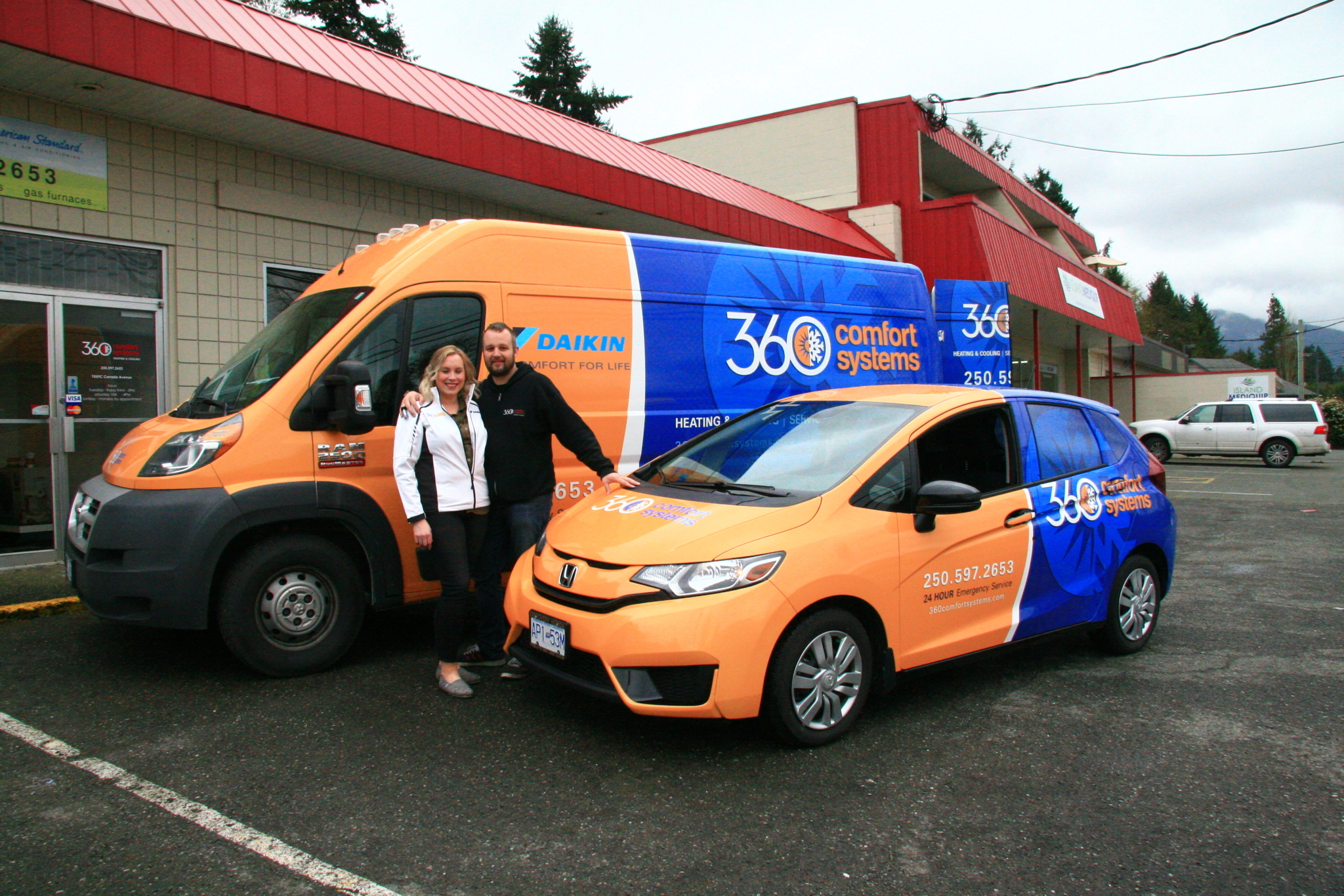 360 Comfort Systems in Duncan: Reed and Erika with newly wrapped vehicles