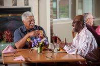 The Village at Ausburg senior living in Baltimore, Md. Friends enjoying dinner.