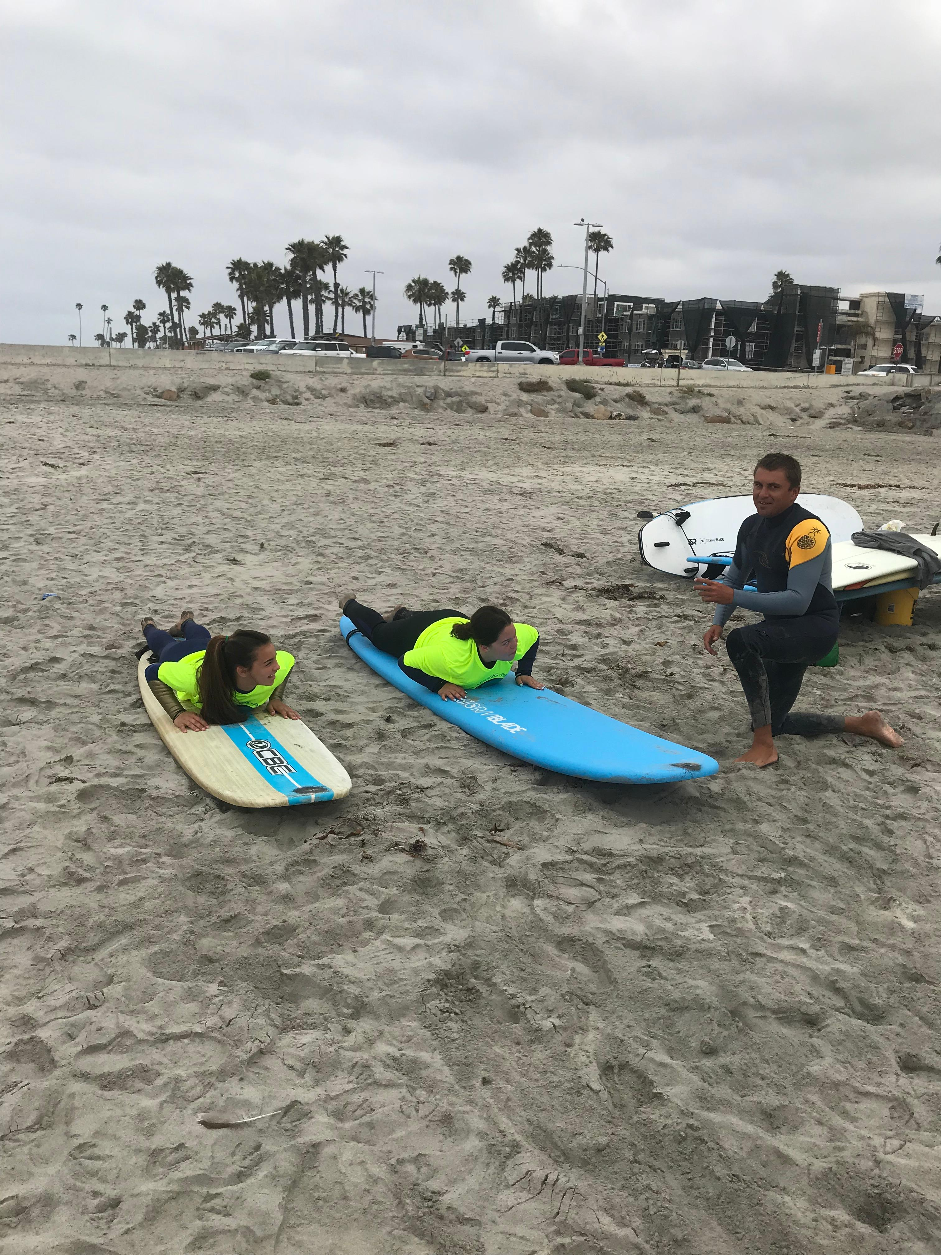 Learning a bit on the sand is the beginning, Safety, paddle, glide Pop up surf, Smile. What a story to share. book at sandiegosurf.com
