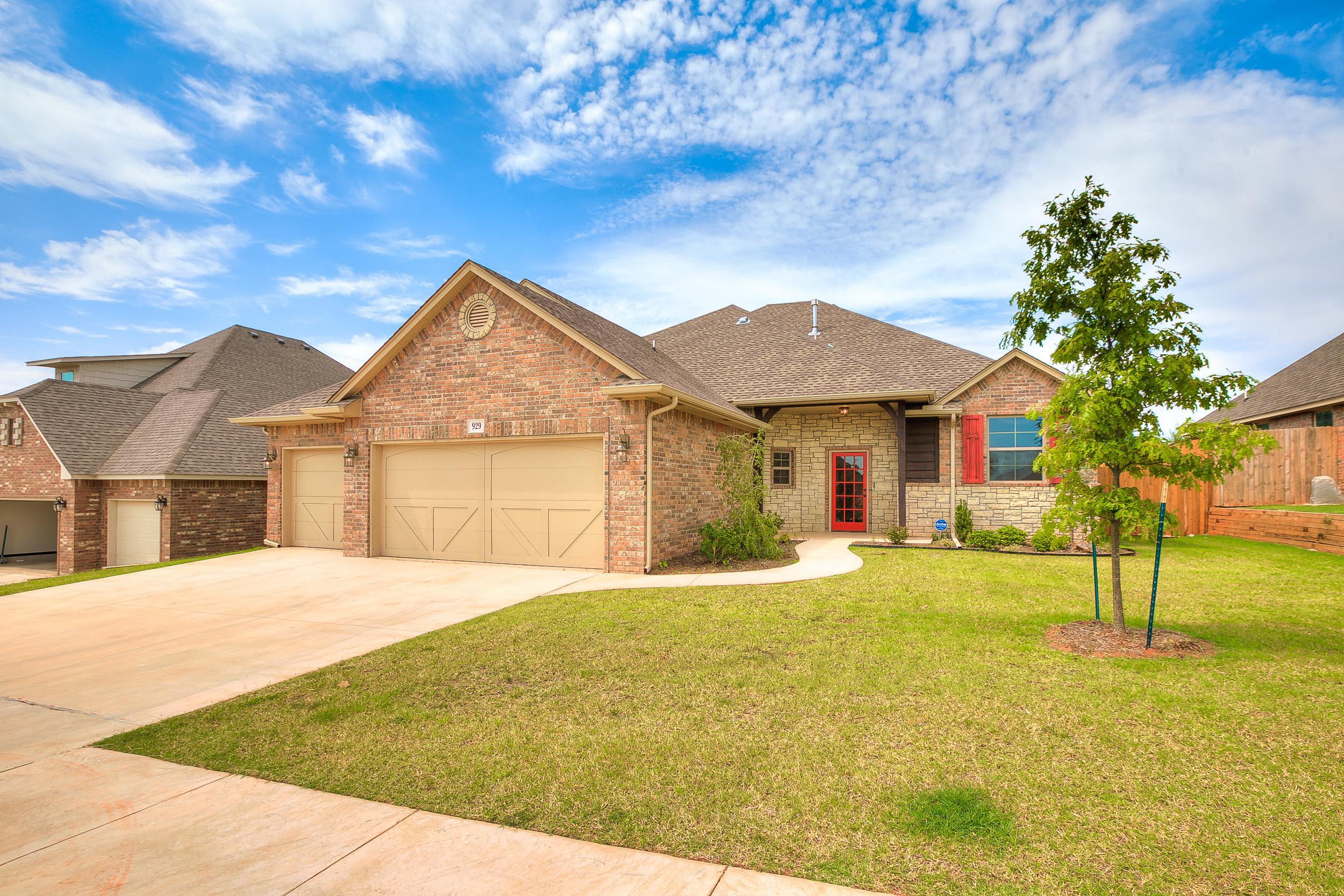 Brass brick homes in edmond ok 73012 for House builders in oklahoma