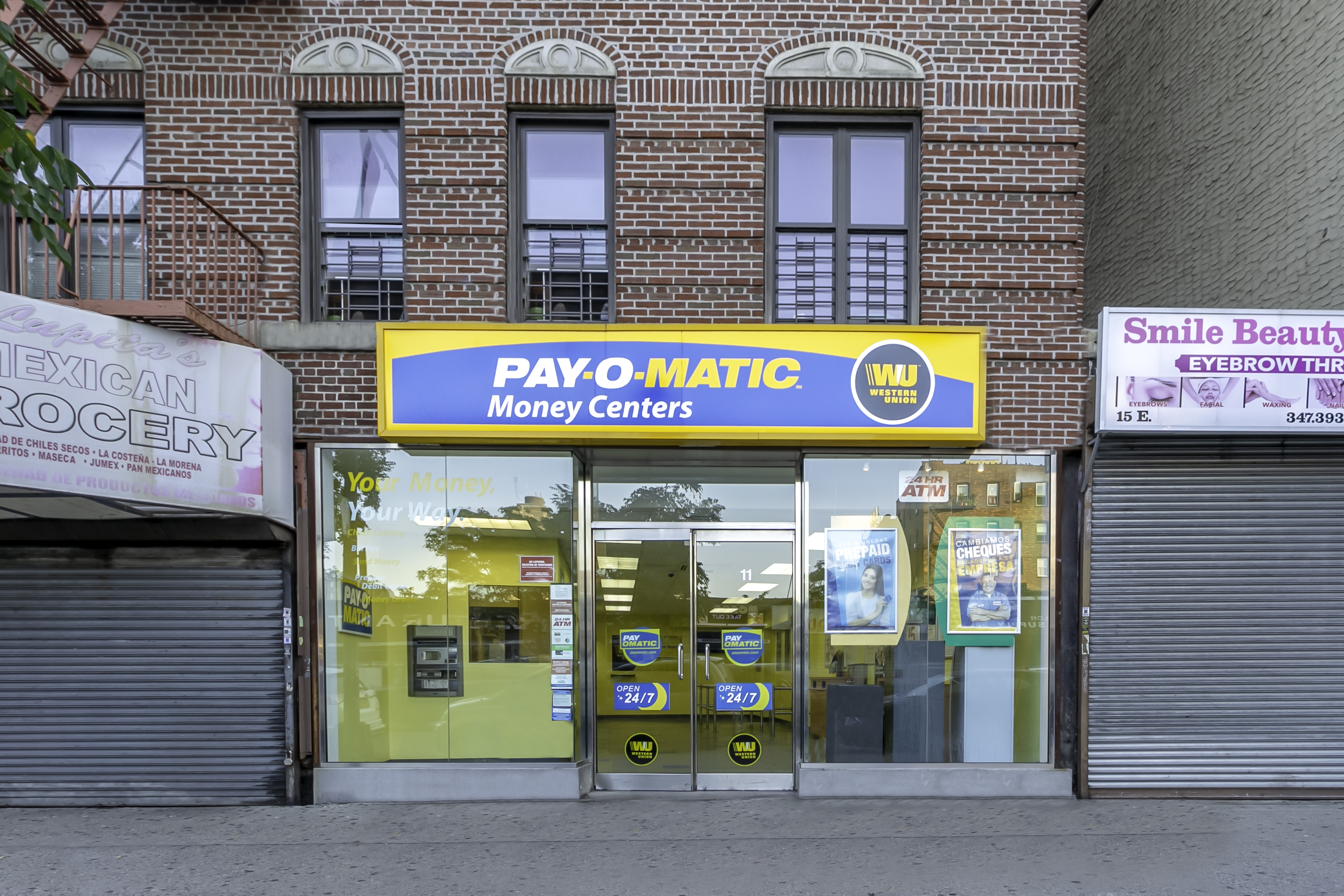 Exterior view from street of PAYOMATIC store located at 11 East Gunhill Road Bronx, NY 10467