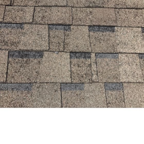 Hail damage on a roof causes granules to come loose from the shingle and bruises the fiberglass mat. This will compromise the water shedding ability of your roof. Call today for a free inspection or visit www.capstoneroofingco.com