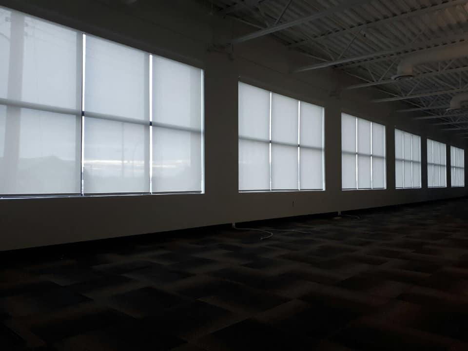 Budget Blinds of Delta, South Surrey and White Rock in Delta: Commercial Space Solar Shades: Offering protection from UV rays and heat, keep your commercial space cool and add curb appeal to any office