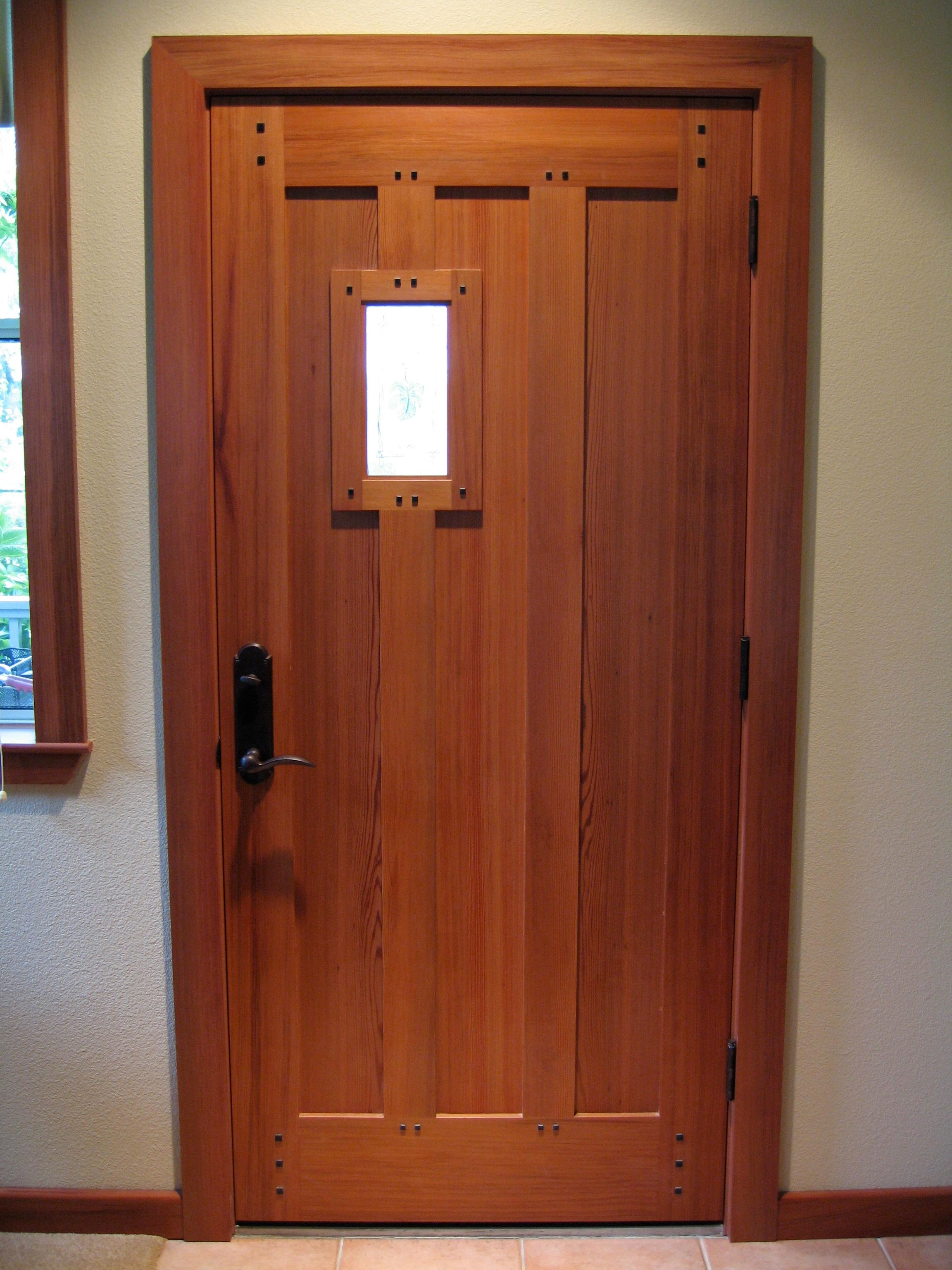 Custom salvaged Redwood mortise & tenon Ebony pegged craftsman door designed & handcrafted by Philip Snyder of PS Woodworking adds elegance and style to the entrance of your home.