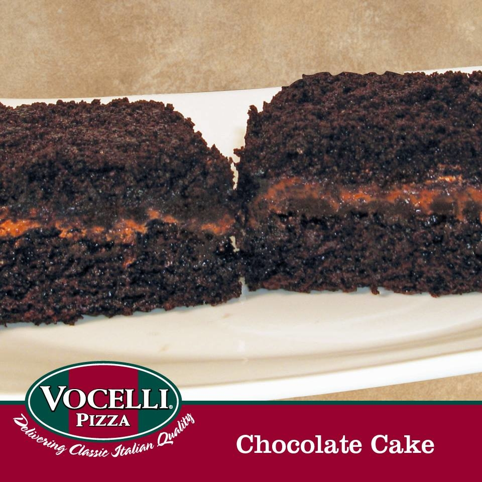 2 pieces of rich dark chocolate cake layered with chocolate cream frosting and covered with chocolate cake crumbs.