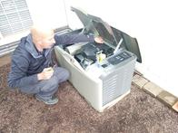 Licensed electrician working on a gernerac generator installation.
