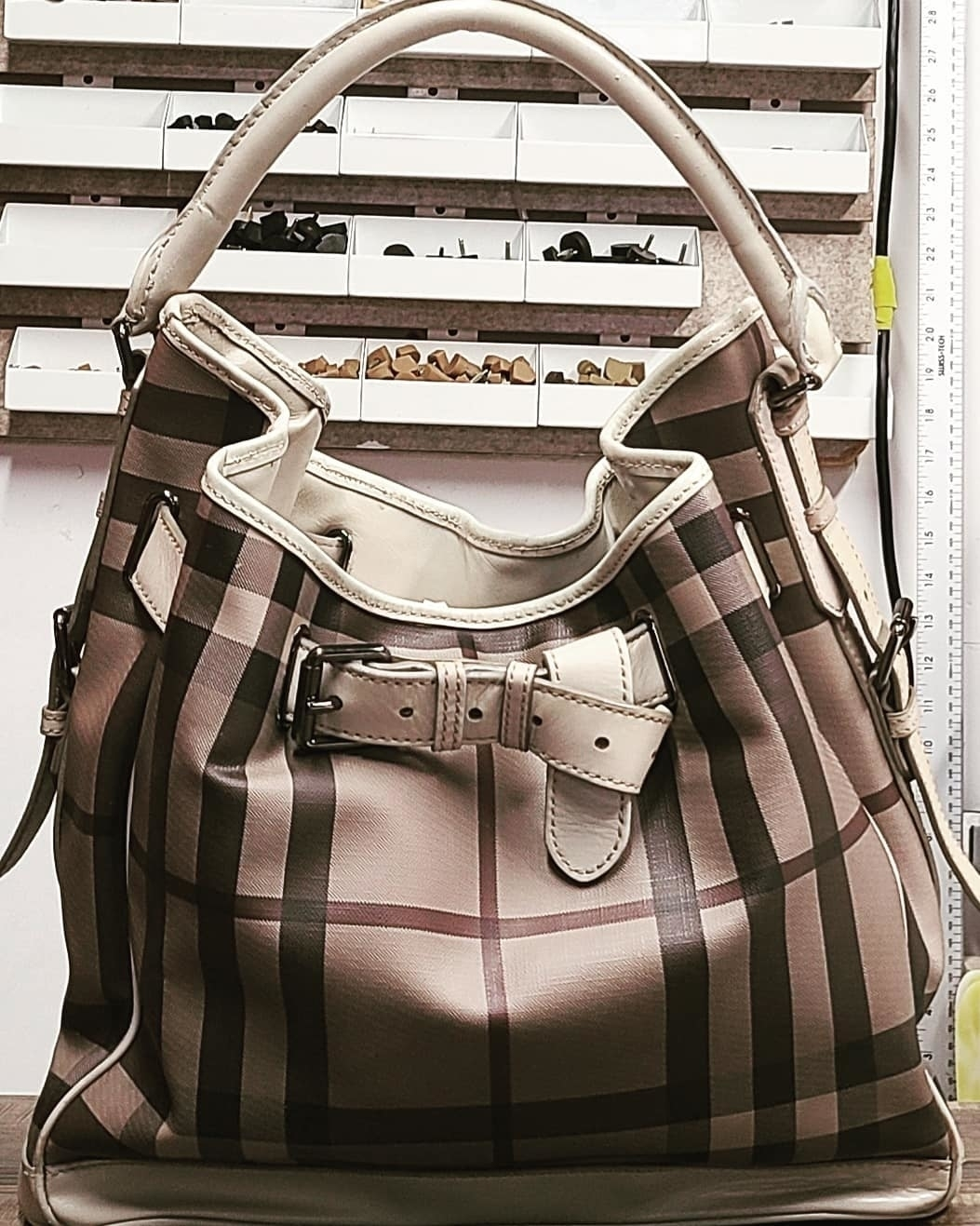 KW Shoe Repair & Sneaker Cleaning Service in Kitchener: We were able restore  this beautiful BURBERRY luxury handbag. This iconic handbag was professionally cleaned inside& outside.