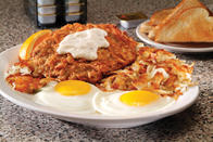 Homestyle Chicken Fried Steak & Eggs - Tender steak, breaded and deep fried to a golden brown, topped with creamy country gravy, two eggs* cooked to order, hash browns or fresh fruit and choice of toast, biscuit or two pancakes.