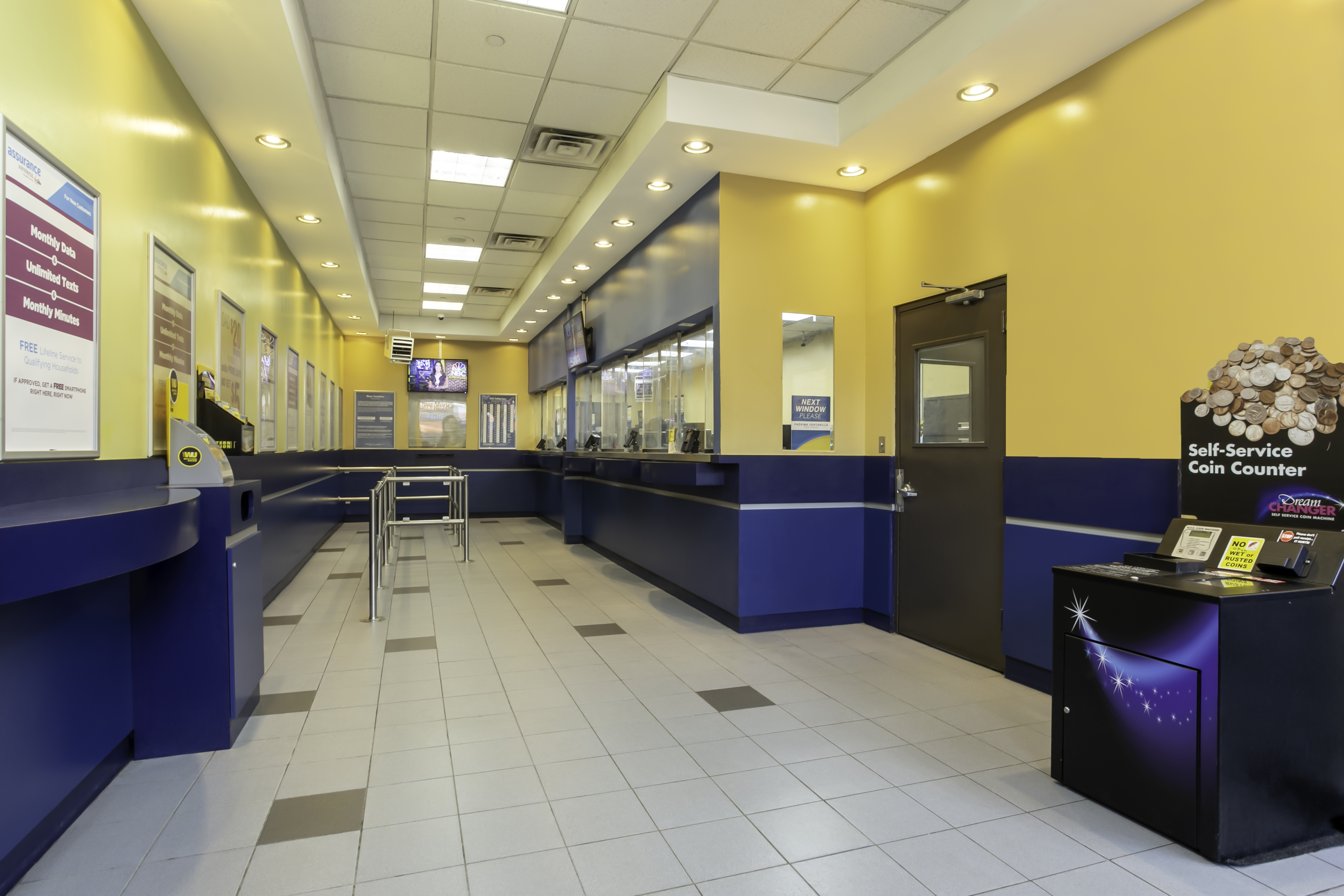 Customer waiting area and teller windows inside PAYOMATIC store located at 159 East 170th St Bronx, NY 10452