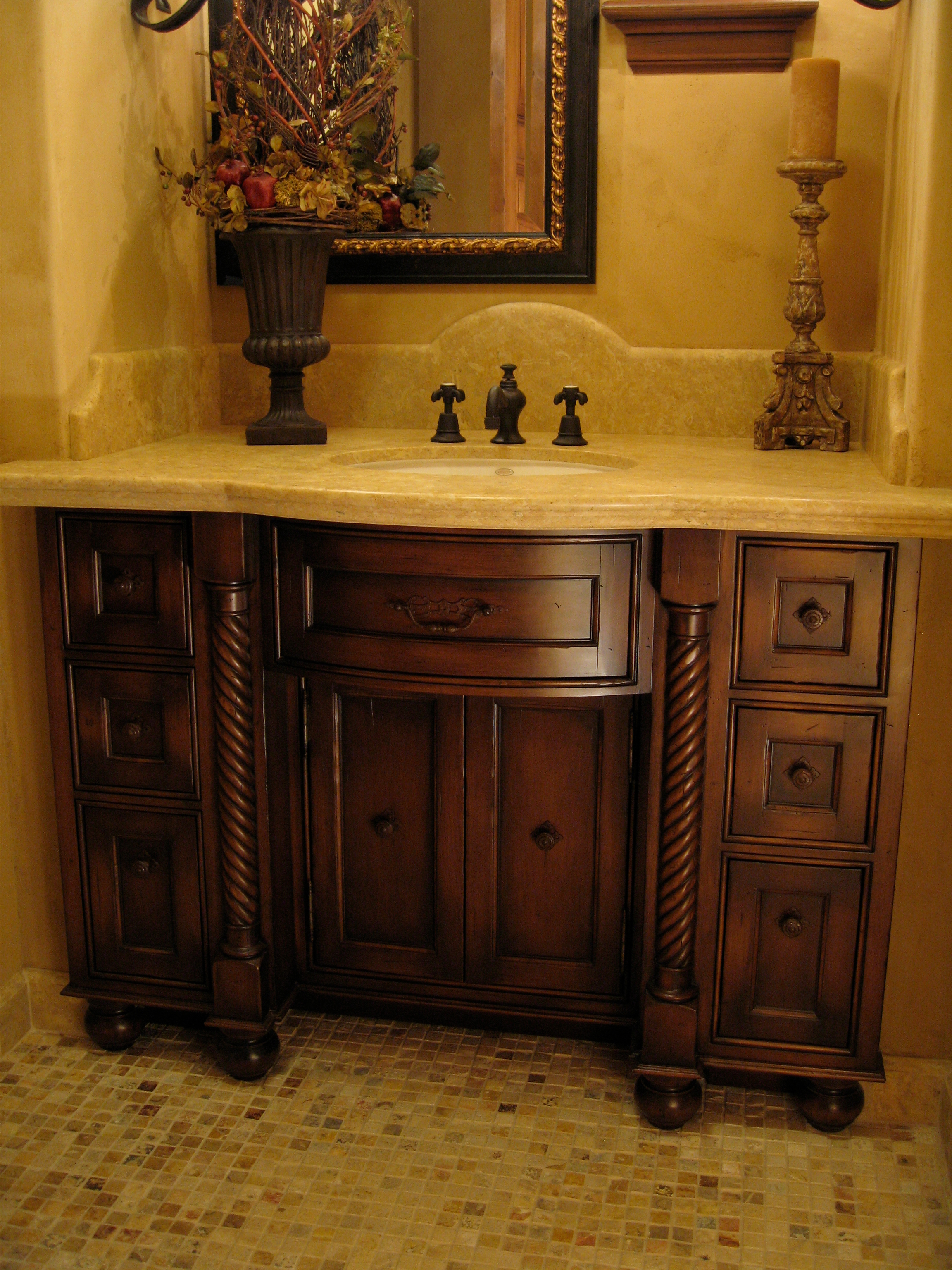Bow front vanity in distressed Alder with rope twist columns, handcrafted and ultimately designed by Philip Snyder of PS Woodworking.