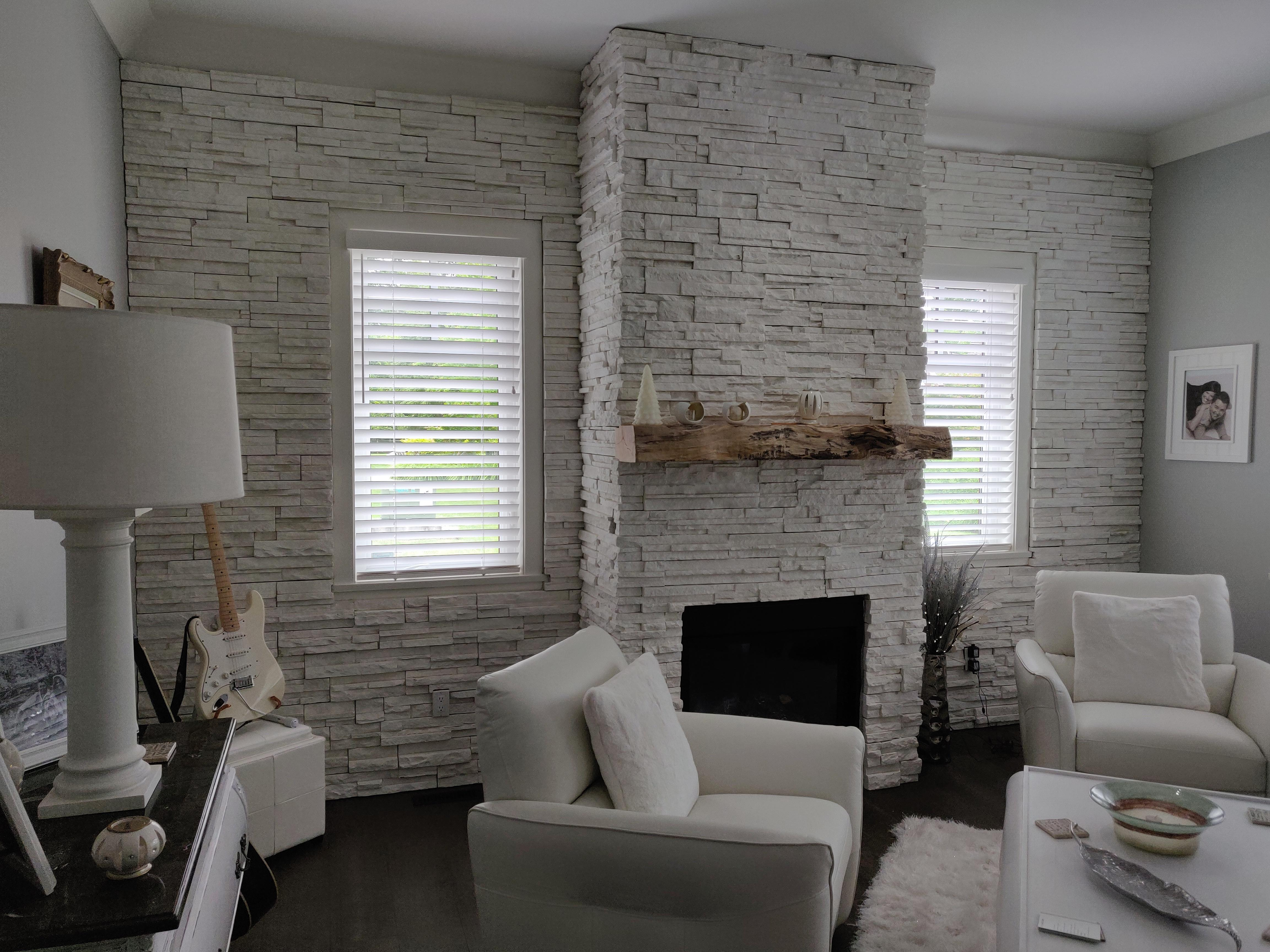 Budget Blinds of Delta, South Surrey and White Rock in Delta: Faux Wood blinds to compliment the clean white look of a custom fireplace wall